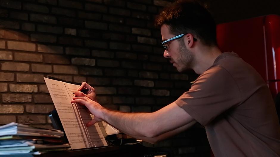 lukas-kobela-composing-writing-notes