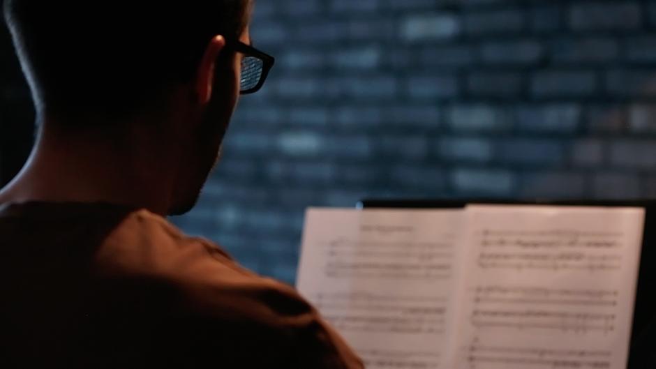 lukas-kobela-playing-piano-sheets
